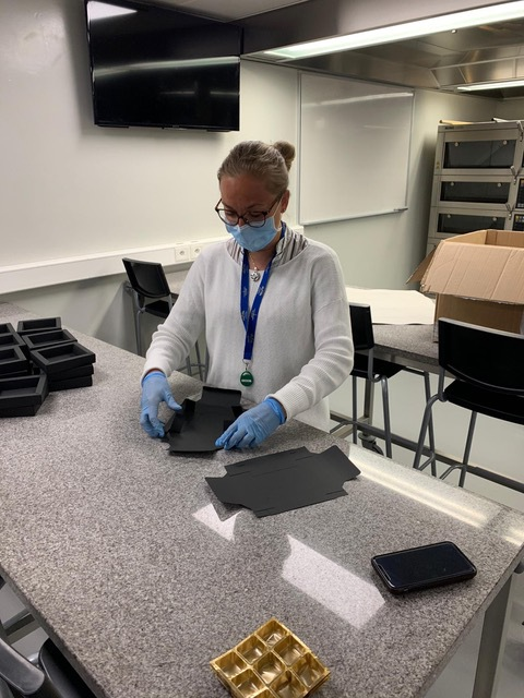Prepare chocolates boxes for the medical staff at a regional hospital