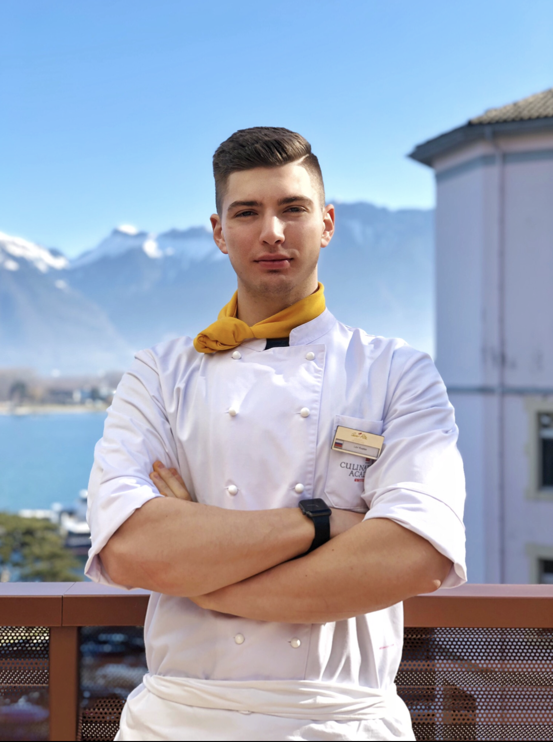 Lavr Kozlov posing with mountains behind him