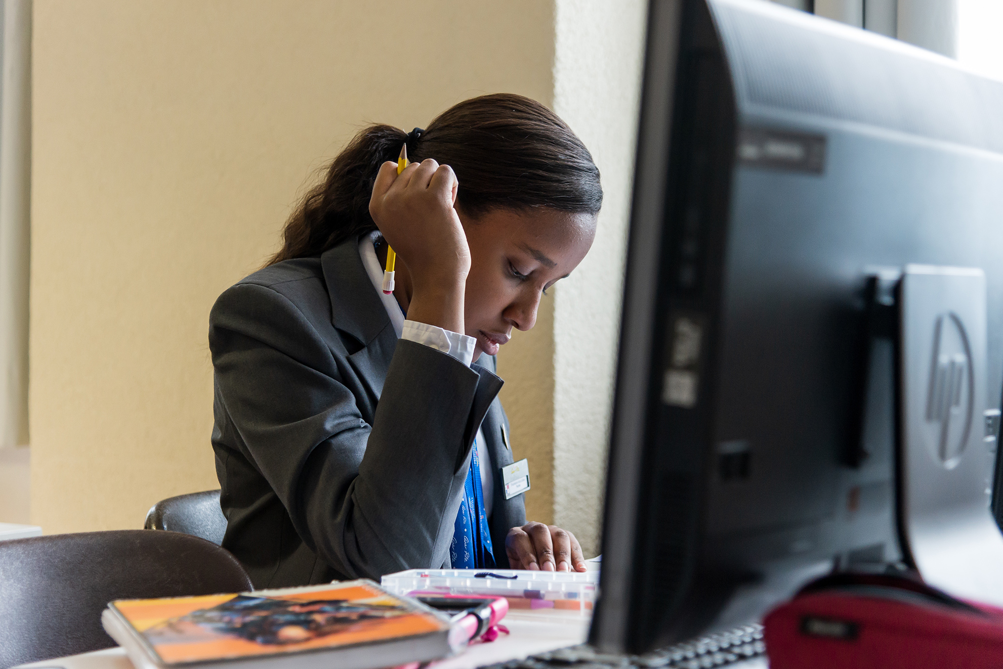 A student is studying at a computer