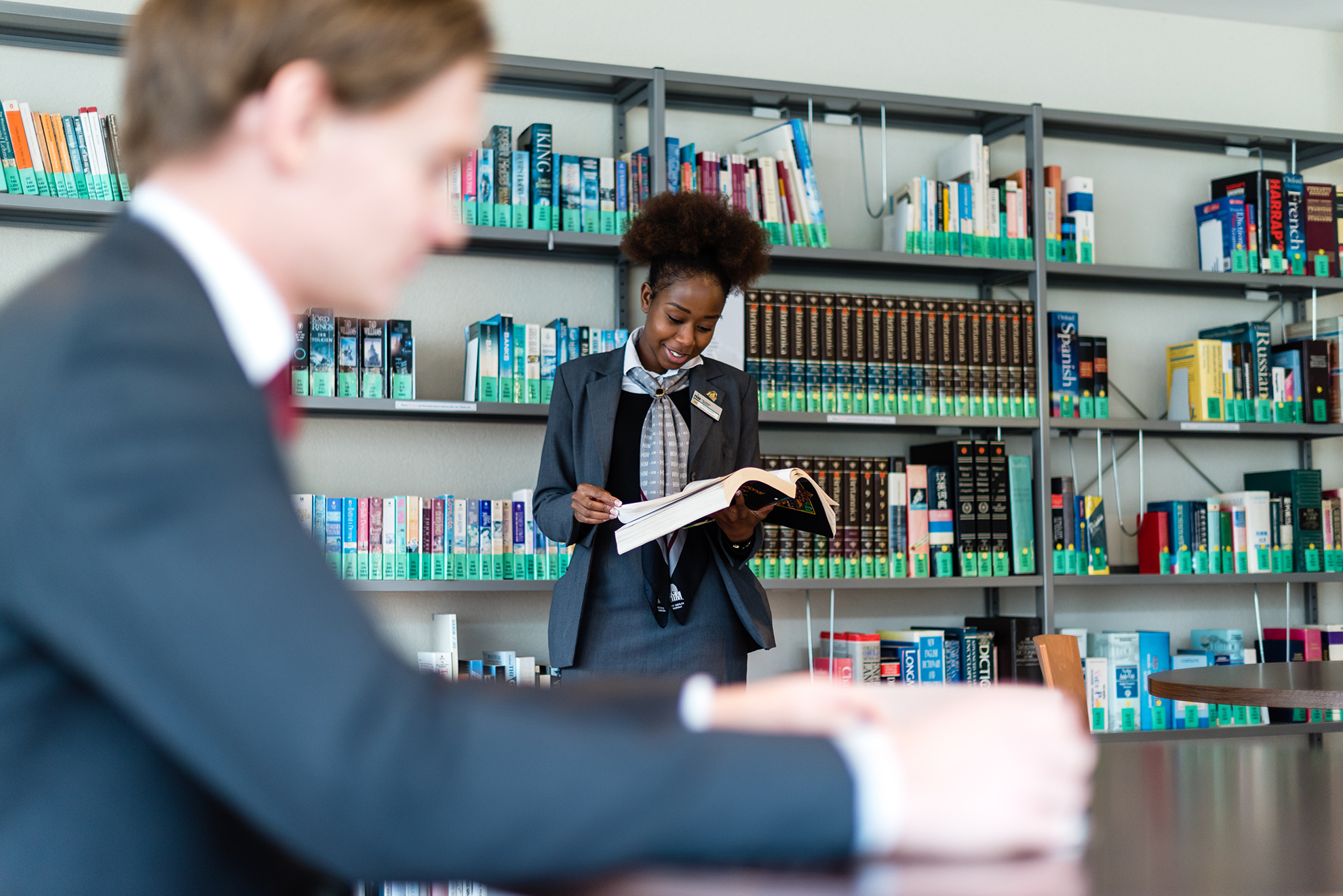 Hospitality management school students working together in library