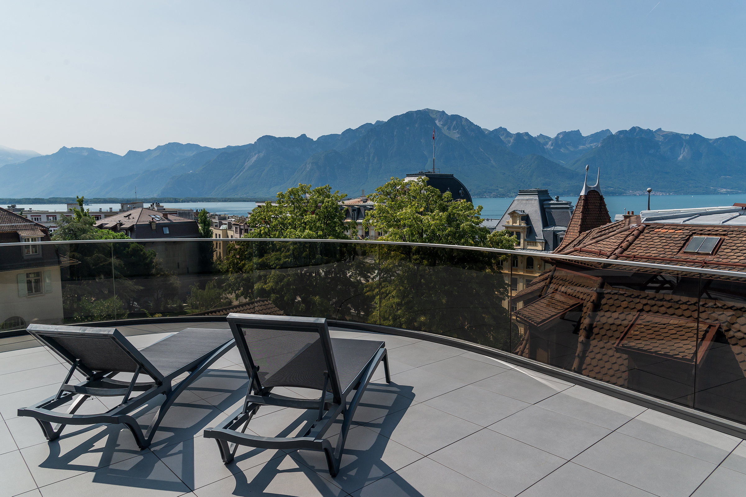 View from a terrasse at HIM Hotel Institute Montreux overlooking Lake Geneva and the Alps
